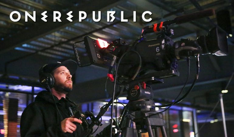 Camera operator filming during the shoot of a One Republic concert
