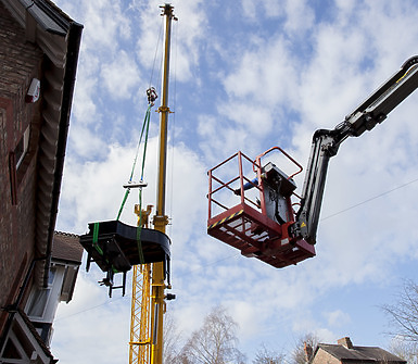 Piano being lifted by a crane
