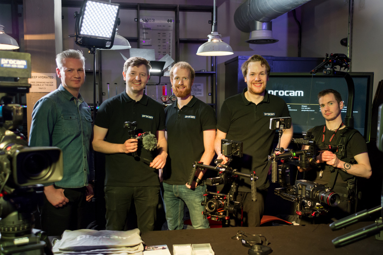 Procam crew standing behind a table at a Careers Festival
