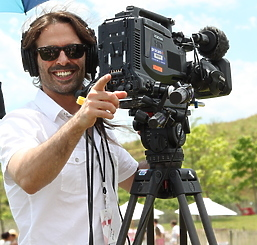 Cameraman smiling with a camera