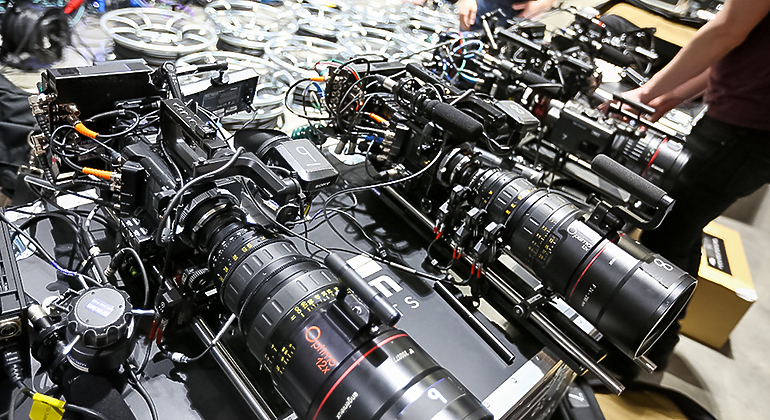 rows of cameras on the floor