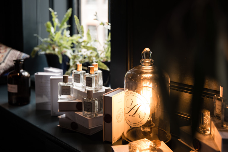 Perfume bottles and a light on a vanity