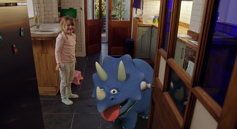 Girl in house with animated pet dinosaur