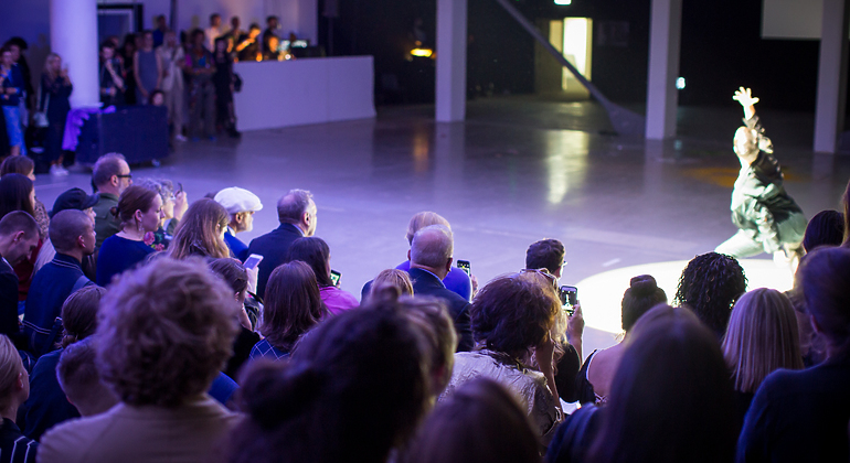 a model walking in the center of a crowd
