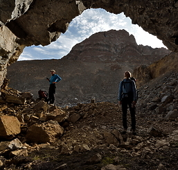Images of team at mouth of cave in 2015 expedition