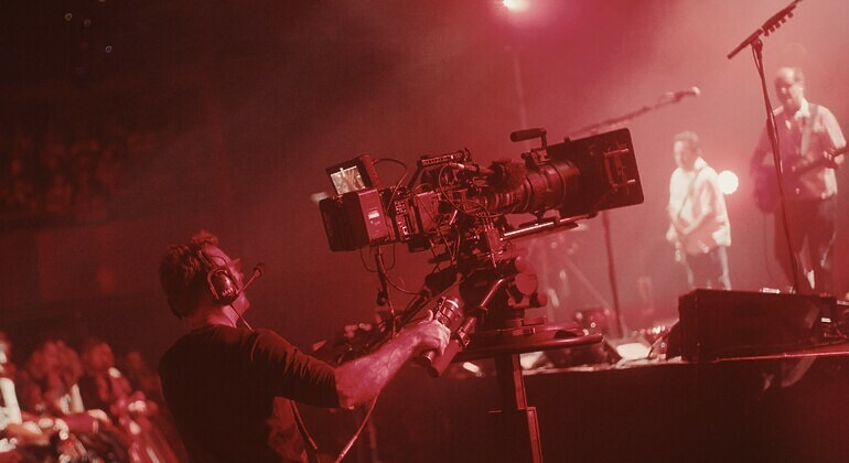 camera operator filming the band