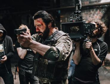 behind the scenes cameraman filming soldier